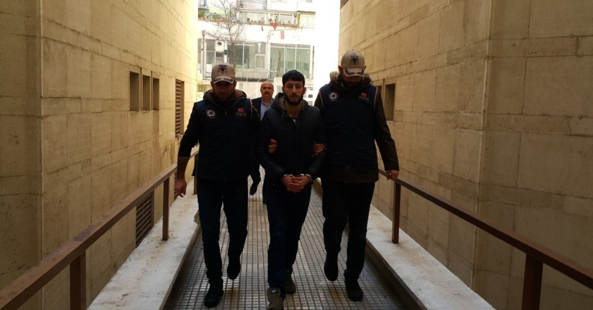 Police officers escort a Daesh suspect to a courthouse in Bursa, March 4, 2019.