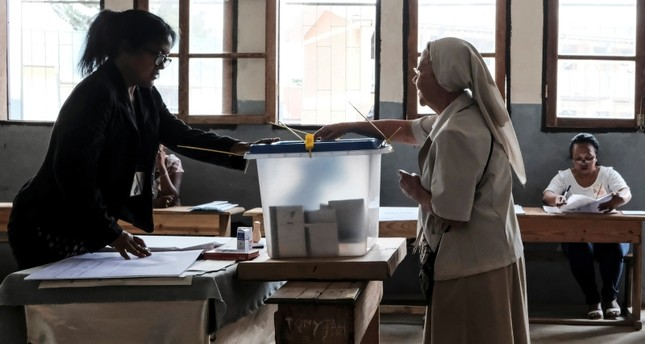 A voter casts her vote at a polling station in Antananarivo, Madagascar, Wednesday, Nov. 7, 2018. (AP Photo)