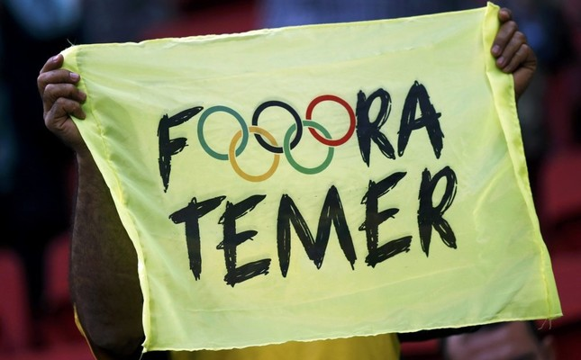 A banner reads Out Temer in reference to the interim Brazilian President Michel Temer.