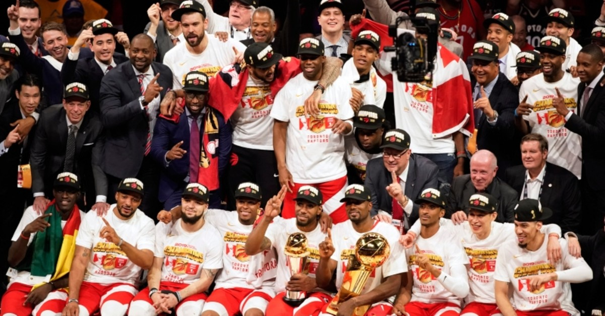 Toronto Raptors players and coaches celebrate after the Raptors defeated the Golden State Warriors in Game 6 of basketball's NBA Finals in Oakland, Calif., Thursday, June 13, 2019. (AP Photo)