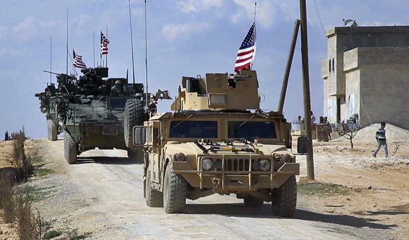 Frame grab from video provided by Arab 24 network, shows U.S. forces patrol on the outskirts of the Syrian town, Manbij, a flashpoint between Turkish troops, FSA and U.S.-backed YPG, in al-Asaliyah village. March 2014. (Via AP)