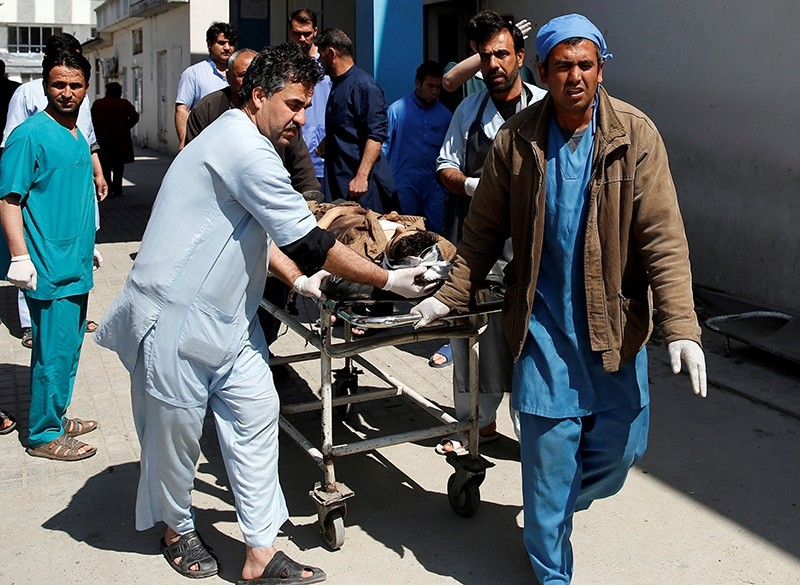 Men transport a victim at a hospital after a blast in Kabul, Afghanistan March 21, 2018. (Reuters Photo)