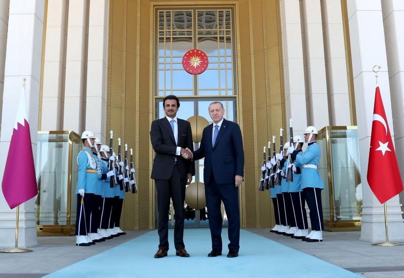 Turkey's President Recep Tayyip Erdogan (R) and the Emir of Qatar Sheikh Tamim bin Hamad Al-Thani shaking hands prior to their talks in Ankara.