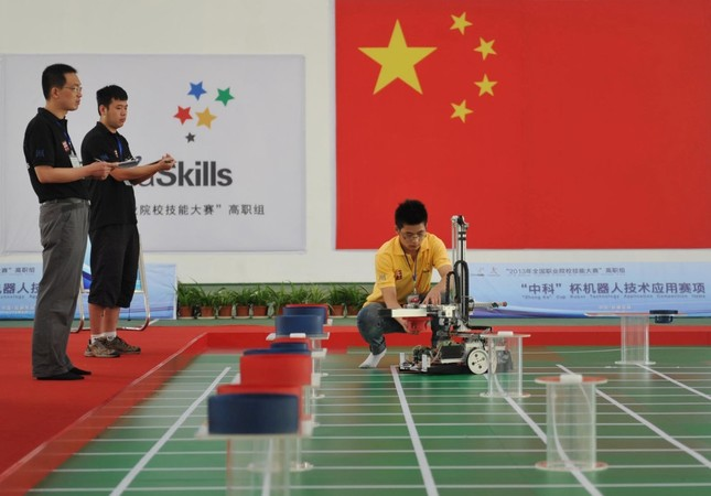 A participant operates a robot during a competition in Wuhu, Anhui province.