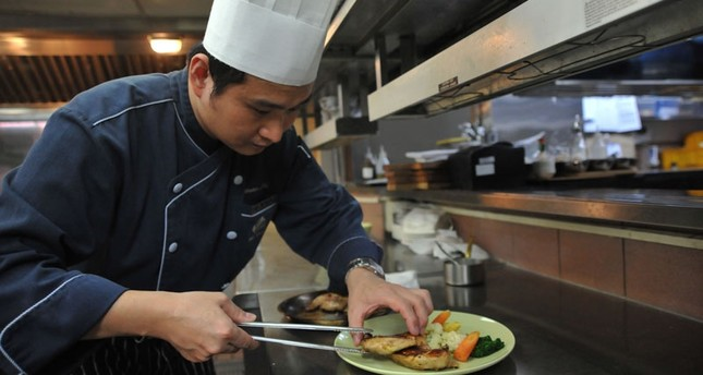 This photo taken on January 19, 2018 shows a chef preparing a Halal meal at the Gaia Hotel, which caters to tourists from Muslim-dominant countries, in the Beitou district near Taipei. (AFP Photo)
