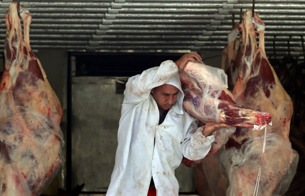 A butcher unloads beef from a truck outside a butcher's shop in Sao Paulo, Brazil, July 27, 2017.