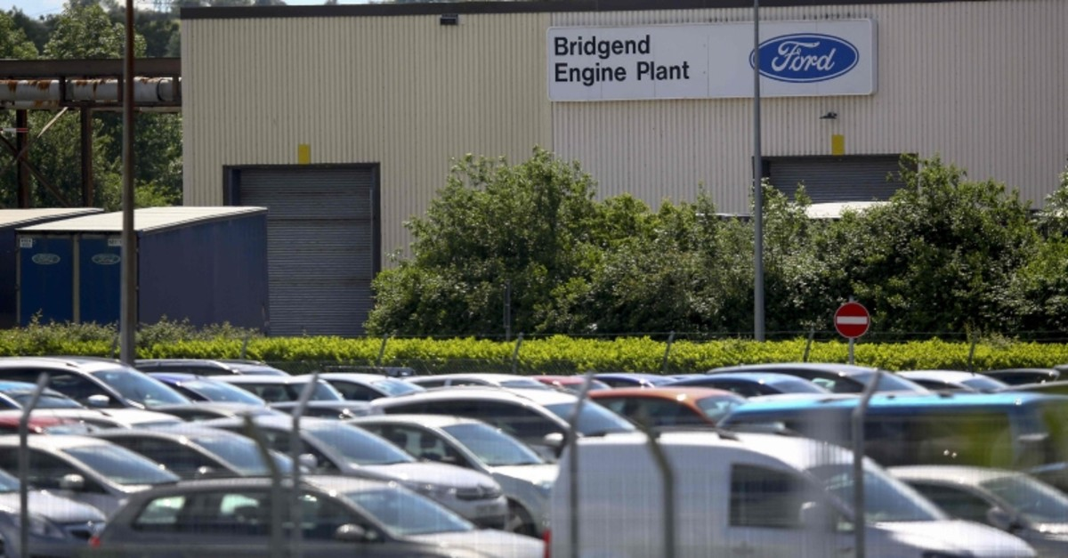 Cars are parked beside the Ford Bridgend Engine plant in south Wales on June 6, 2019, on the day that news was confirmed that the plant is to close next year. (AFP Photo)