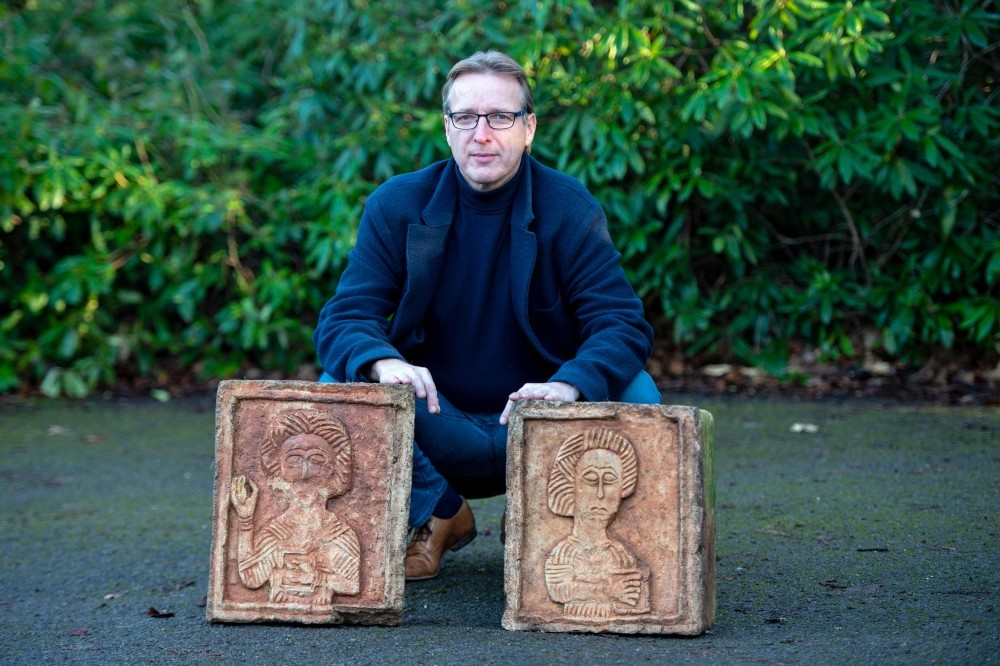Dutch art detective Arthur Brand poses for a photograph with two limestone Visigoth reliefs from the 7th century in north London on Jan. 20, 2019.