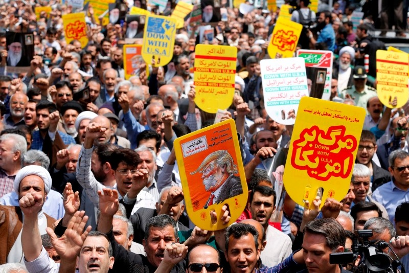 Iranians hold anti-U.S. placards and shout slogans during a demonstration amid high tensions following the U.S. withdrawal from the nuclear deal, May 11.