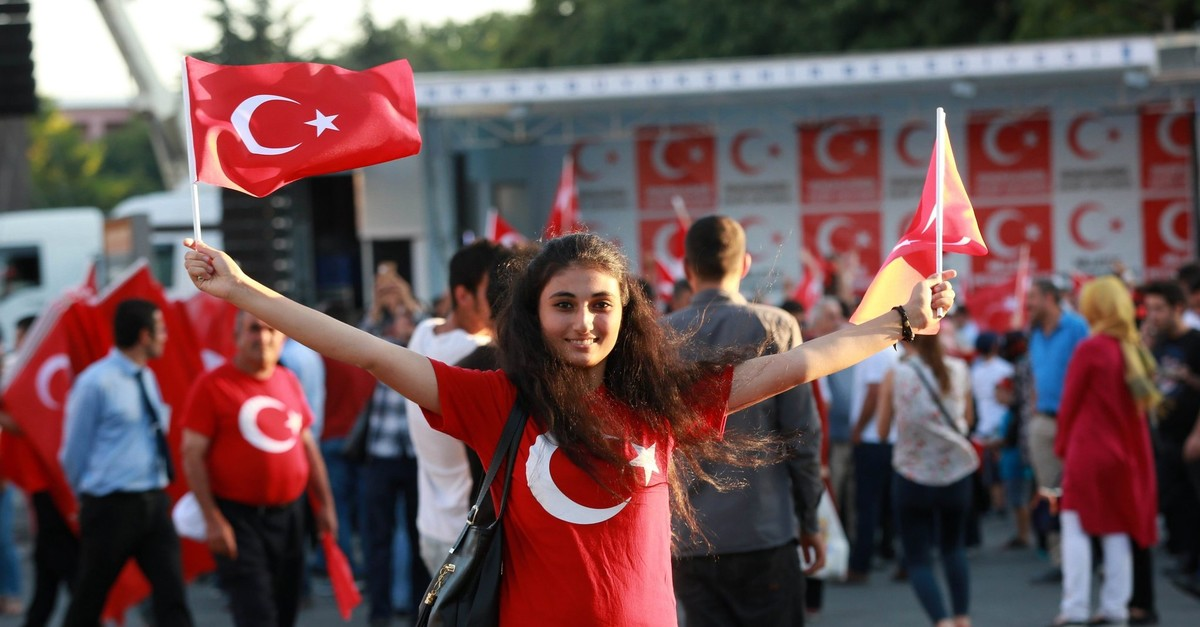 A woman waves Turkish flags in Ku0131zu0131lay square in Ankara, July 25, 2016.
