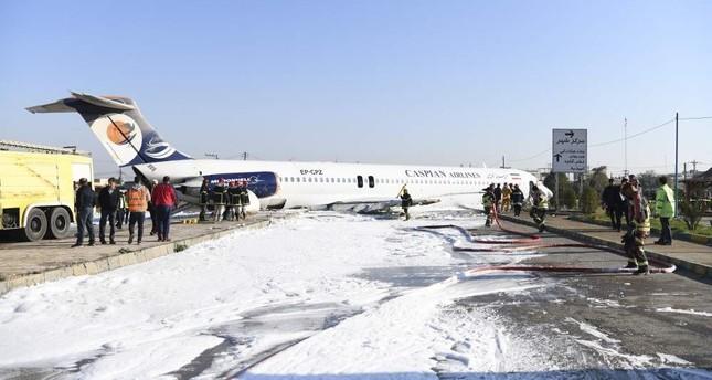 Iranian airliner overruns runway, stops on highway