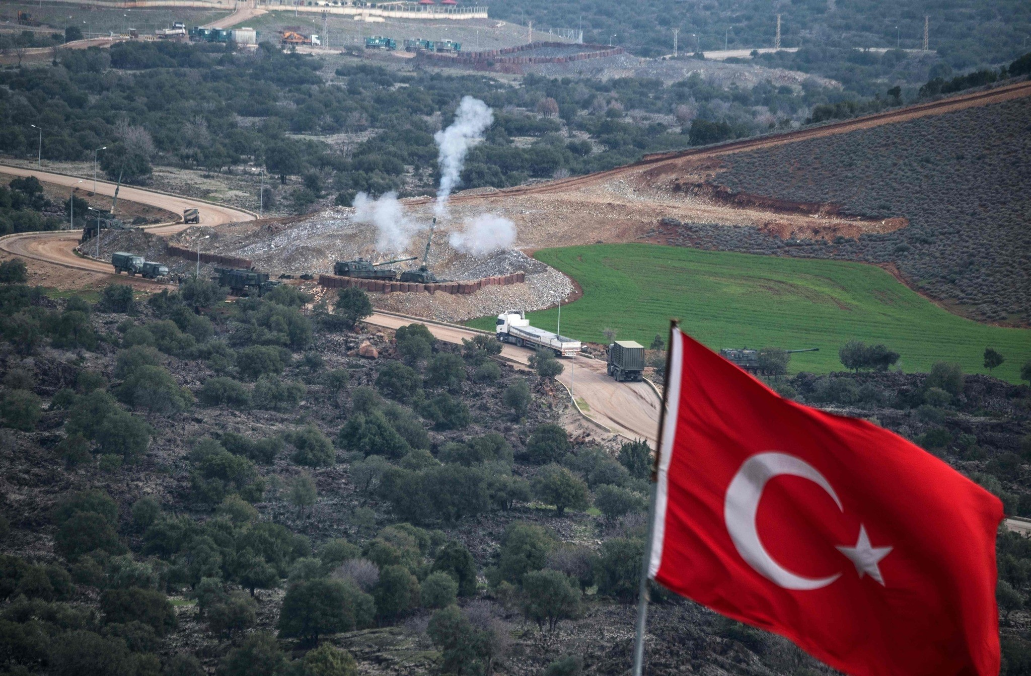 Turkish artillery shell YPG terrorist positions near the Syrian border as part of the Afrin offensive, Hatay, Turkey, Jan. 21.