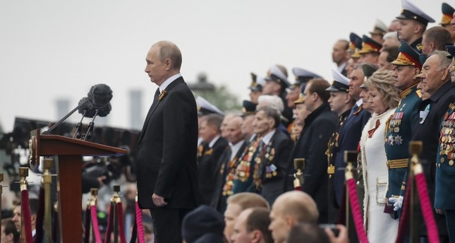 Russian President Vladimir Putin observes a minutes of silence during the Victory Day parade, which marks the anniversary of the victory over Nazi Germany in World War Two, in Red Square in central Moscow, Russia May 9, 2019. (Reuters Photo)