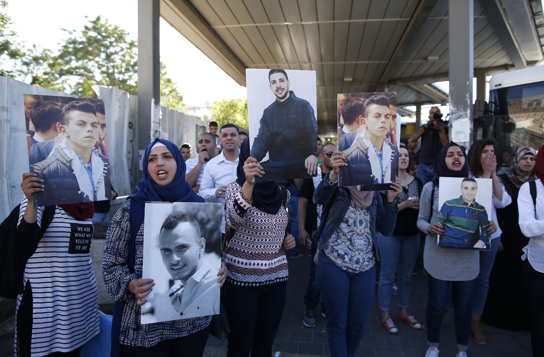 Families of Palestinians imprisoned in Israeli jails demonstrate in Jerusalem's Old City on Saturday in support of hundreds of Palestinian prisoners on a hunger strike.