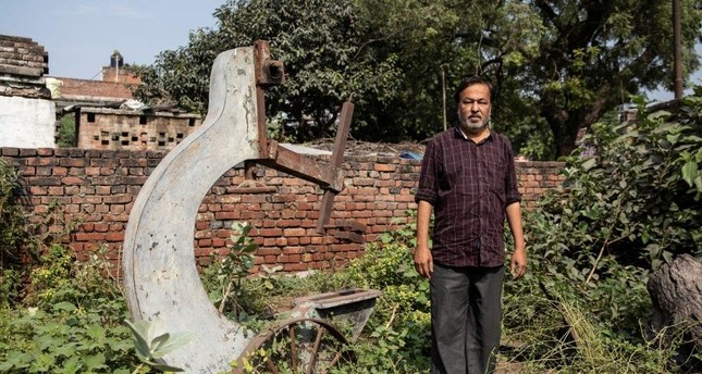 Mohammed Shahid, grandson of Haji Abdul Gaffar, the last imam of Babri mosque, poses in front of machinery from a sawmill burnt down by a mob after the demolition of the mosque, Ayodhya, India, Oct. 22, 2019. (Reuters Photo)