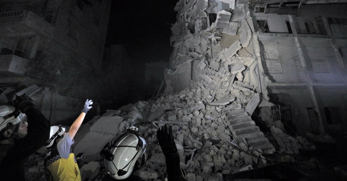 Members of the Syrian Civil Defence (White Helmets) search for victims as a building collapsed days after a reported air strike on the town of Ariha, in the south of Syriau2019s Idlib province, July 31, 2019.