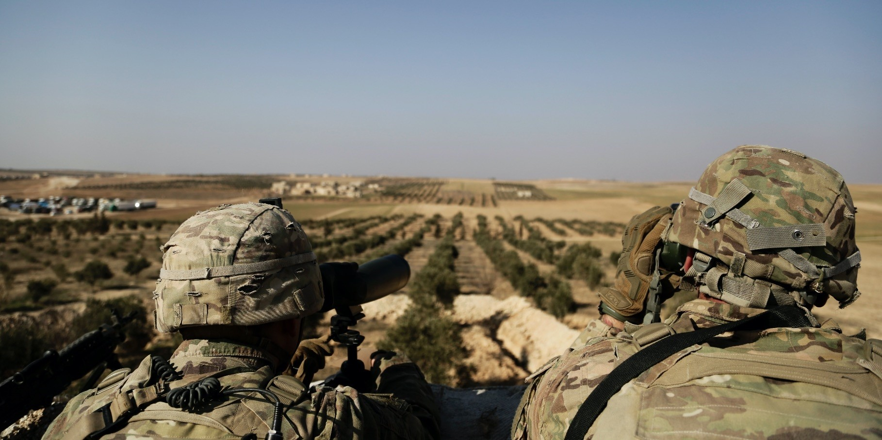U.S troops look out toward the border with Turkey from an outpost near the town of Manbij, Syria, Feb. 7.