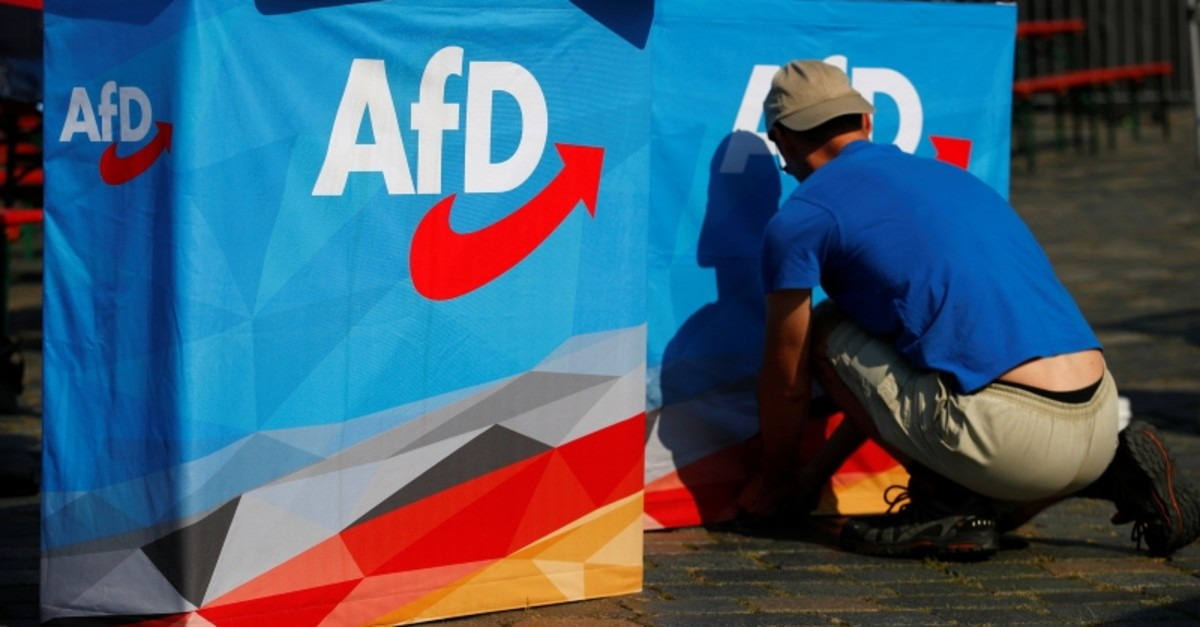 A man helps to set up banners at an election campaign of far-right Alternative For Germany (AFD) party ahead the upcoming Saxony state elections in Dresden, Germany, Aug. 25, 2019. (Reuters Photo)