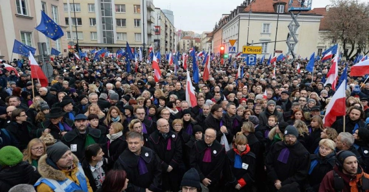 Judges and lawyers from across Europe, many of them dressed in their judicial robes, march silently in Warsaw, Poland, Saturday, Jan. 11, 2020. (AP Photo)