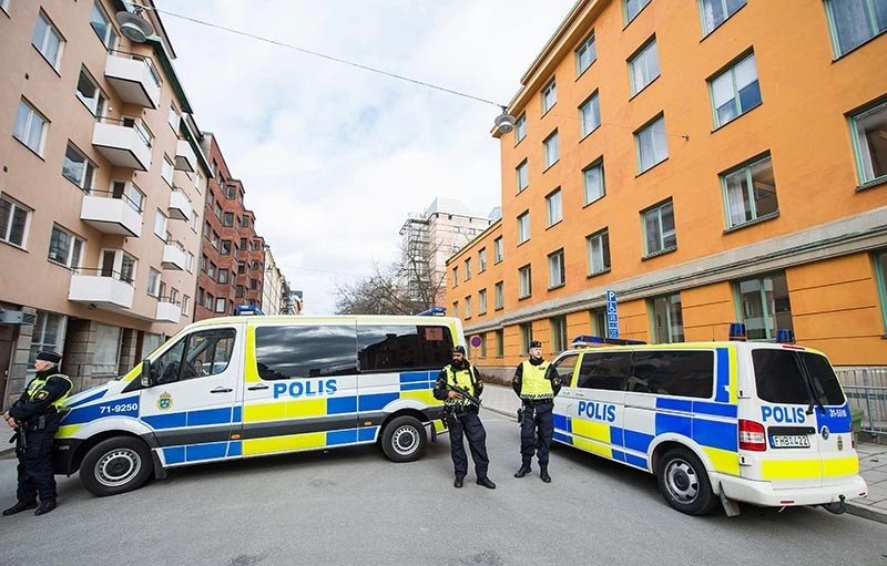 Police vans block the street outside the Stockholm District Court  (AFP Photo)