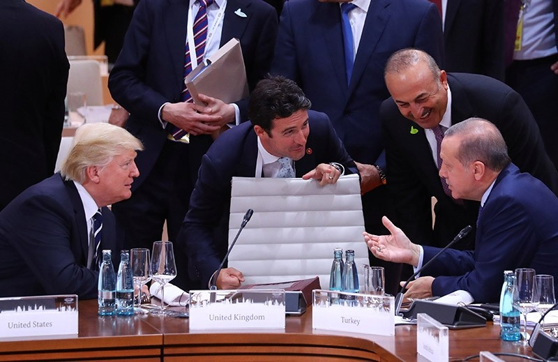 U.S. President Donald Trump, Interpreter Emrah Kale, President Recep Tayyip Erdou011fan and Foreign Minister Mevlu00fct u00c7avuu015fou011flu talk during the working session at the G20 leaders summit in Hamburg, Germany, July 7, 2017. (Reuters Photo)