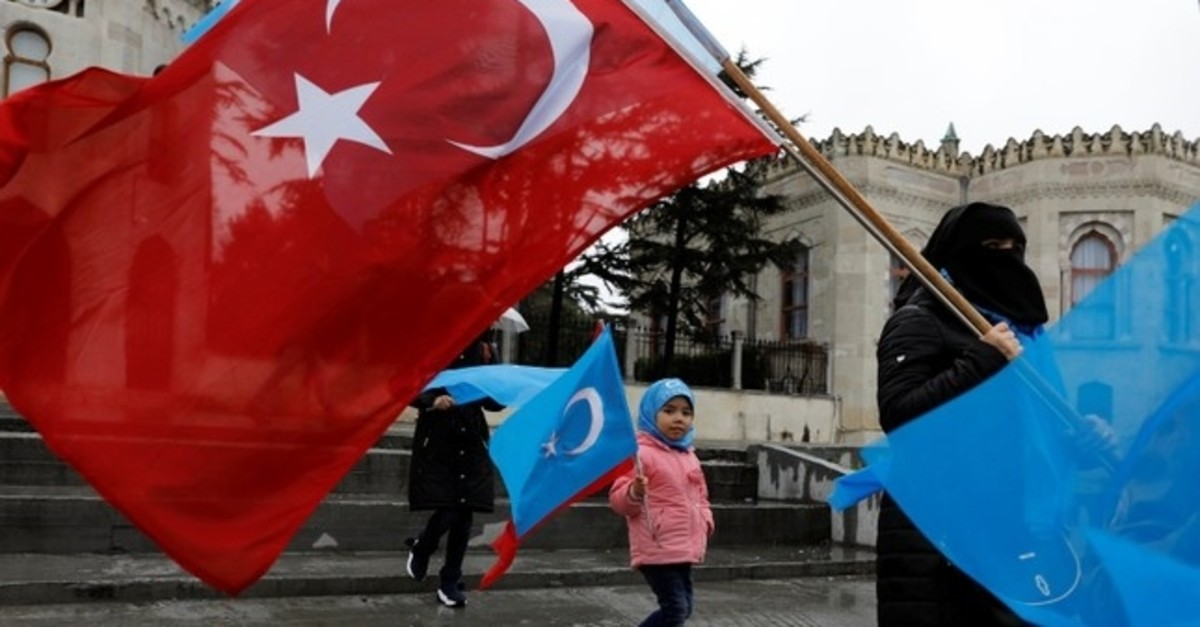 This file photo shows ethnic Uighur demonstrators hold East Turkestan and Turkish flags during a demonstration against China in Istanbul, Turkey, February 23, 2019. (Reuters Photo)