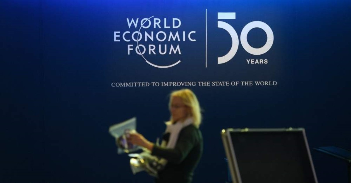 A staff member prepares translators in the Congress Center ahead of the annual meeting of the World Economic Forum (WEF), Davos, Jan. 20, 2020. (AFP Photo)
