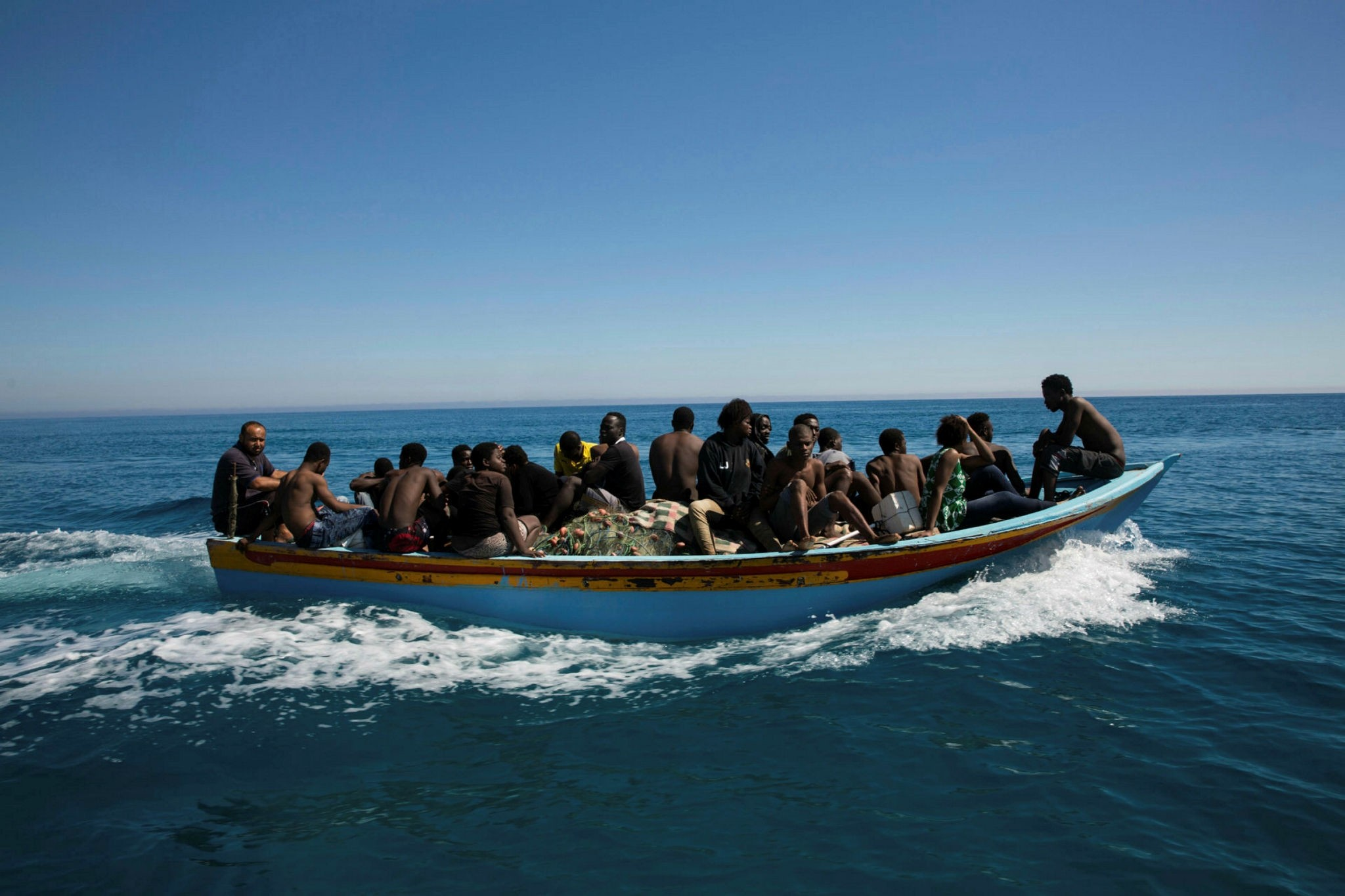 Migrants on a boat after they were rescued by the Libyan coastguard in the Mediterranean off the Libyan coast, July 8.