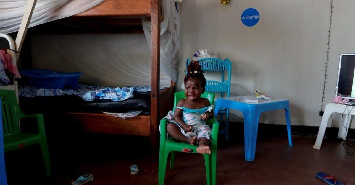 A child cries as she sits at a U.N. Children's Fund (UNICEF) creche for children whose families are suspected or confirmed Ebola cases, Beni, Oct. 7, 2019. (Reuters Photo)