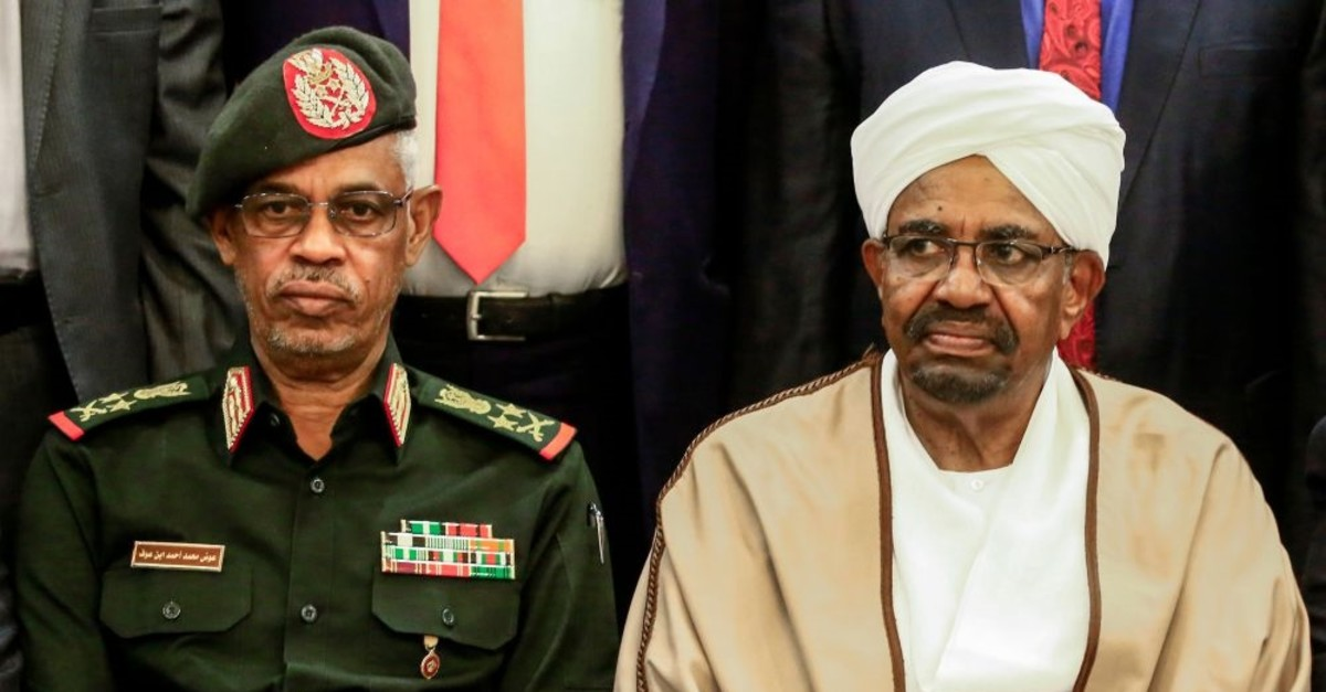 Sudan's military ousted President Omar al-Bashir (R) is seen seated alongside Defense Minister Awad Mohammed Ibn Ouf, March 14, 2019.