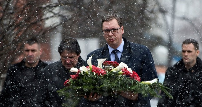Serbia's President Aleksandar Vucic attends a wreath laying ceremony at the site of the attack where Kosovo Serb politician Oliver Ivanovic was assassinated in the northern, Serb-dominated part of Mitrovica, Kosovo (AP Photo)