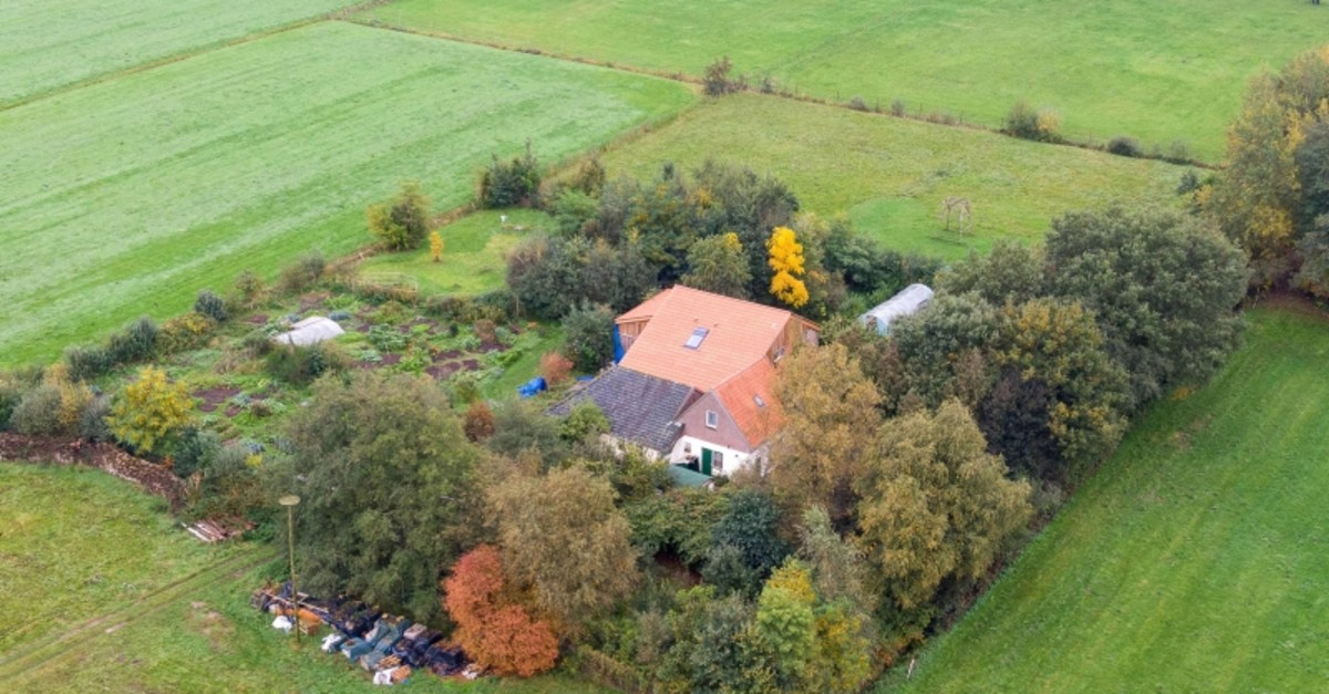 This aerial picture taken on October 15, 2019 shows a farmhouse in a remote area of northern Netherlands' province of Drenthe, near the village of Ruinerwold. (AFP Photo)