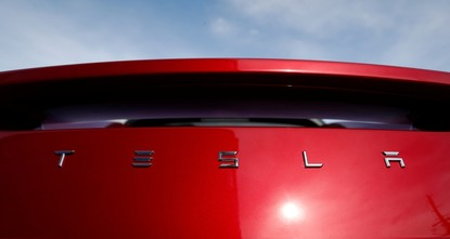 Tesla to cut 9 percent of staff in bid to become profitable