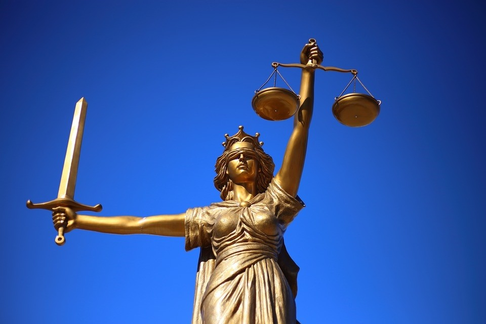 The statue of Lady Justice, also known as Justitia in Latin, allegorically symbolizes the fairness of justice with a woman blindfolded and holding a balance scale and a sword.