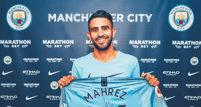 Manchester City signs Riyad Mahrez to record club deal