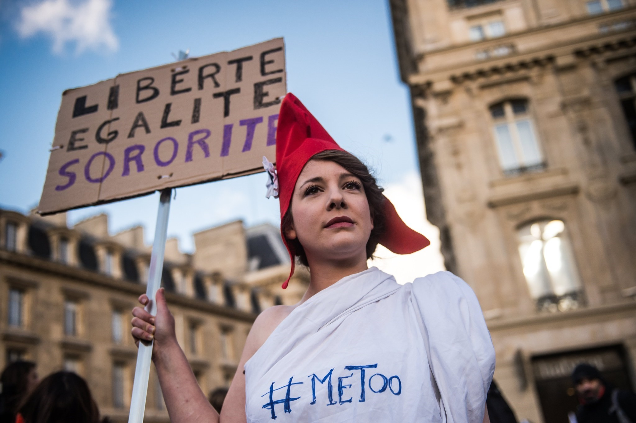 An activist with the #MeToo hastag holds a poster reading 'Liberty Equality Sisterhood' during the International Day for the Elimination of Violence Against Women march in Paris, Nov. 25, 2017. (EPA Photo)