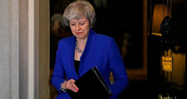 Britain's May to miss Davos to focus on Brexit negotiations