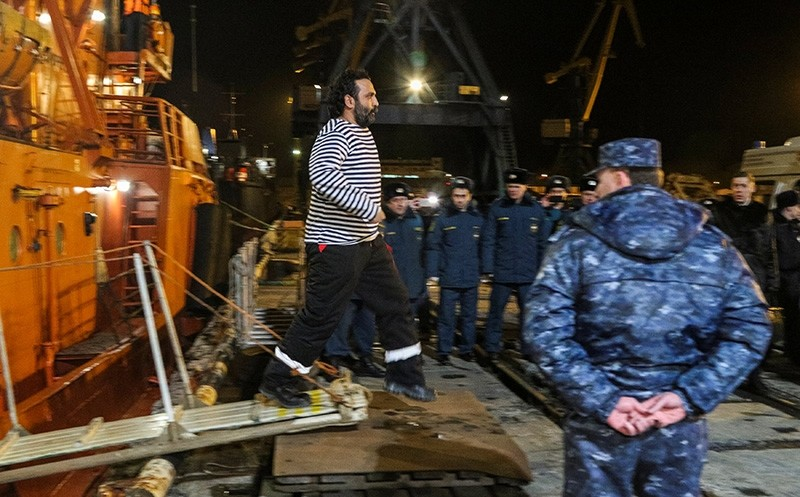 A crew member rescued from one of two ships, which caught fire in the Kerch Strait, disembarks on arrival at a port in Kerch, Crimea, Jan. 22, 2019. (Reuters Photo)