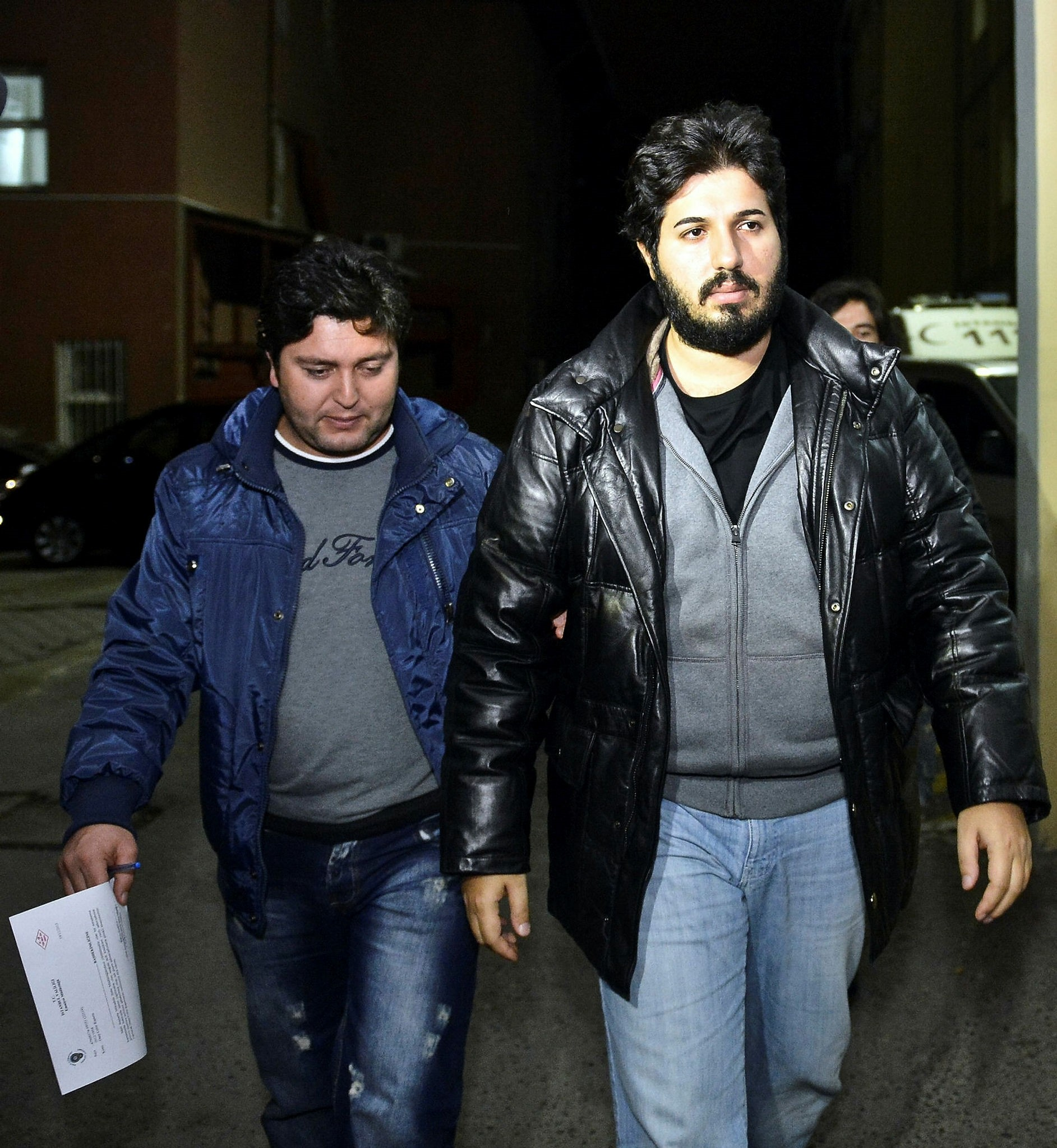 A file photo of the arrested Turkish-Iranian gold trader Reza Zarrab (R).