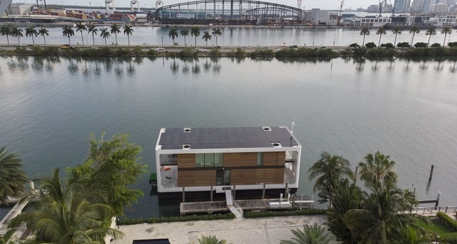 An aerial view from a drone shows the Arkup houseboat, a green-energy luxury floating home that can allow owners to adapt as the sea level continues to rise on May 14, 2019 AFP Photo