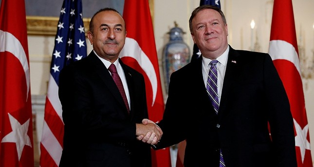 Foreign Minister Mevlüt Çavuşoğlu shakes hands with U.S. Secretary of State Mike Pompeo at the State Department in Washington, U.S., June 4, 2018. (Reuters Photo)