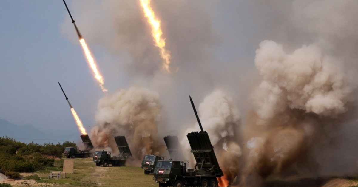 This picture taken on May 4, 2019 and released from North Korea's official Korean Central News Agency (KCNA) on May 5, 2019 shows rocket launchers firing during a test of weapons in an undisclosed location in North Korea. (AFP Photo)