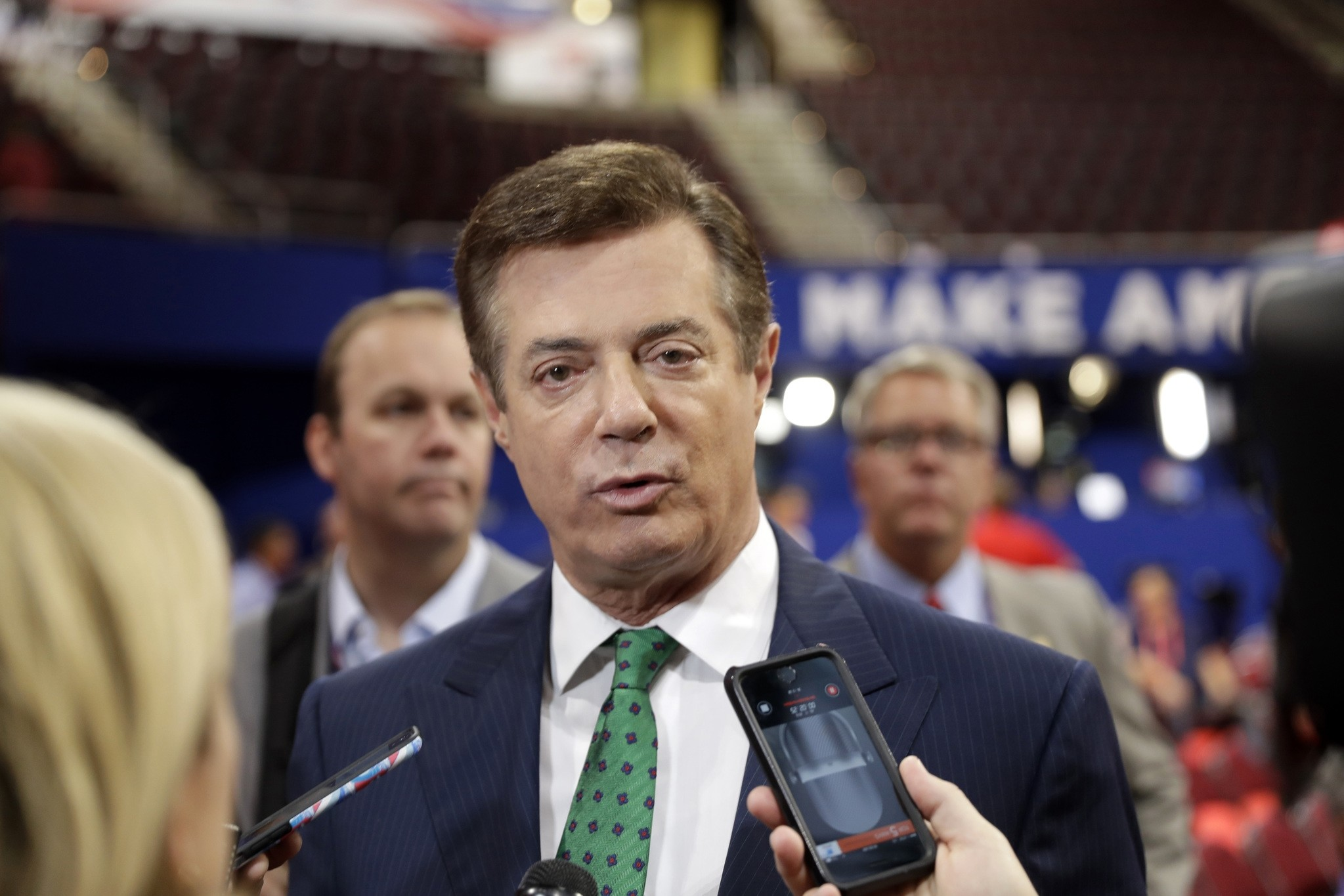In this July 17, 2016 file photo, then-DonaldTrump Campaign Chairman Paul Manafort talks to reporters on the floor of the Republican NC, in Cleveland. (AP Photo)