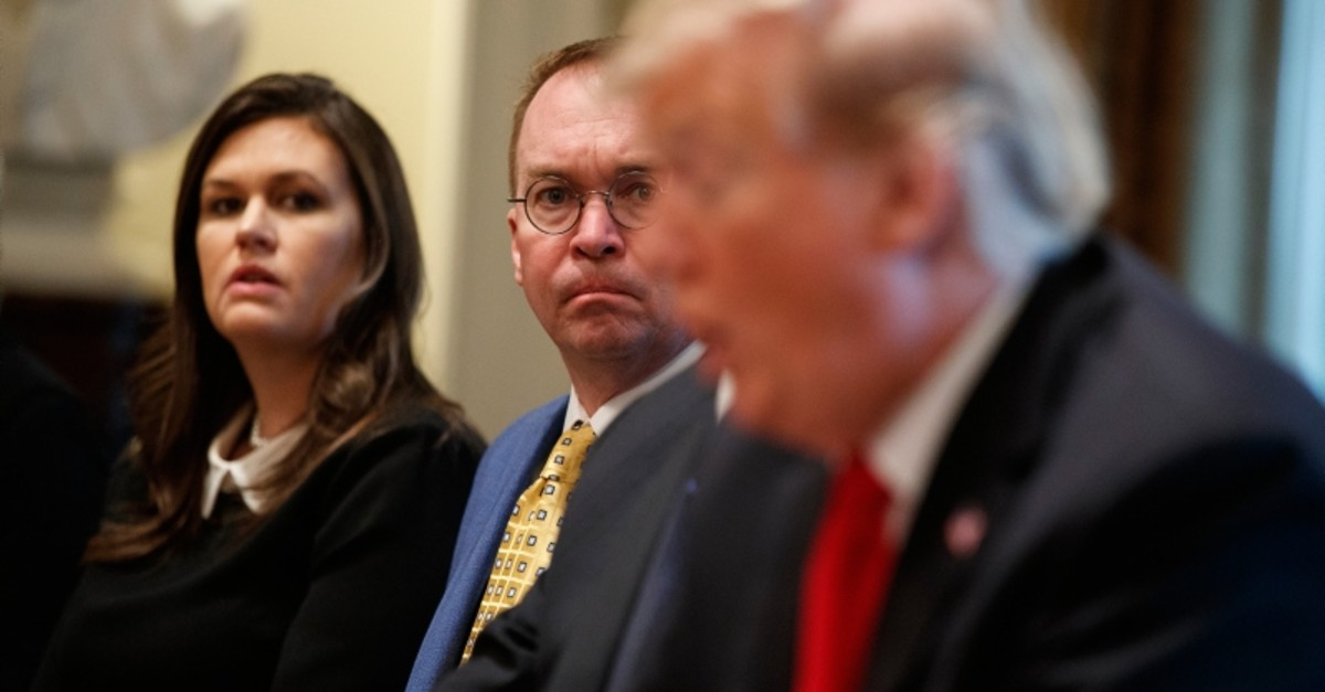 White House press secretary Sarah Sanders and acting White House Chief of Staff Mick Mulvaney listen as President Donald Trump speaks during a meeting in the Cabinet Room of the White House, April 2, 2019, in Washington. (AP Photo)