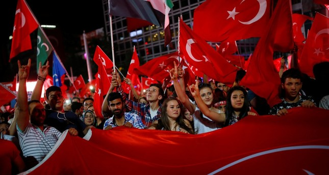 People shouting slogans and waving flags as they gather in solidarity night after night since the July 15 coup attempt in central Ankara, July 27. (Reuters Photo)