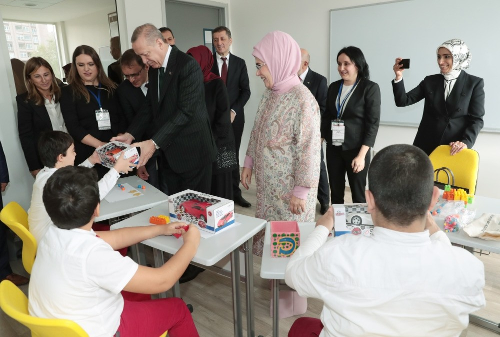 President Erdou011fan and first lady Emine Erdou011fan hand out toys to children at the school after the opening ceremony, Oct. 5.