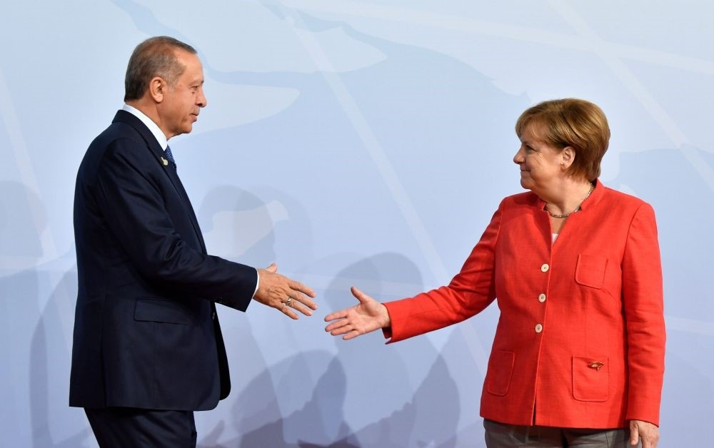 German Chancellor Angela Merkel greets President Recep Tayyip Erdou011fan at the beginning of the G20 Summit in Hamburg, Germany, July 7, 2017.