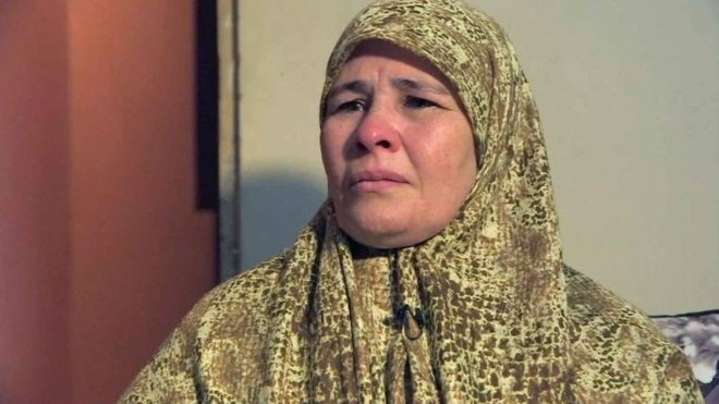 A photo of Mona Mahmoud Mohammed, known as Oum Zubeida, speaking to the BBC.