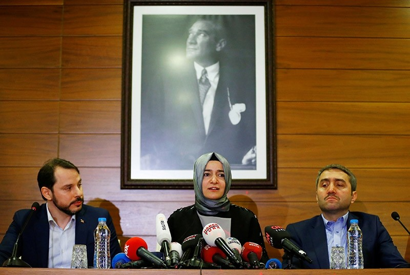 Family and Social Affairs Min. Fatma Betu00fcl Sayan Kaya (C), accompanied by Energy Min. Berat Albayrak (L) and AK Party Istanbul Province Chair Selim Temurci, speaks at a news conference at Atatu00fcrk Int'l Airport in Istanbul, March 12, 2017. (Reuters)