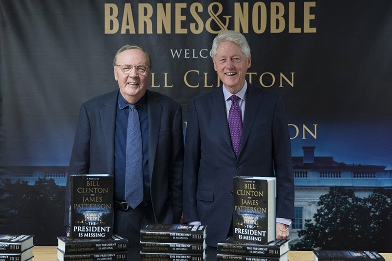 In this June 5, 2018 file photo, former President Bill Clinton, right, and author James Patterson pose for photographers during an event to promote their new novel, ,The President is Missing,, in New York. (AP Photo)